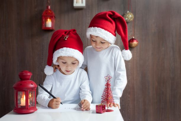 Two-adorable-boys,-writing-letter-to-Santa-000073556451_Full-1